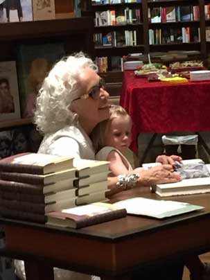 Merilyn Simonds, author, with her granddaughter, at a book signing